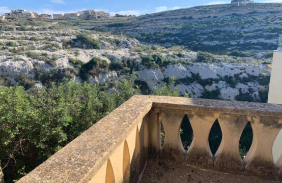 Cliff Edge houses in Xlendi Gozo